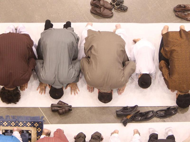 Men pray during the Eid ul Fitr prayer service and celebration at the Reliant Center in Houston. (Agencies)