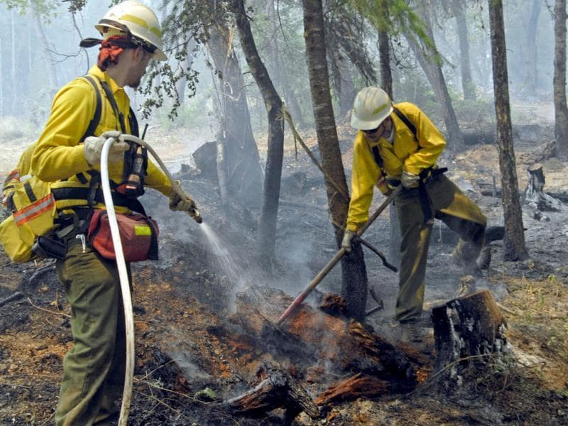 Firefighters conduct mop-up operations - finding and extinguishing hot spots - in the Douglas Complex of fires near Portland, Oregon. AP Photo