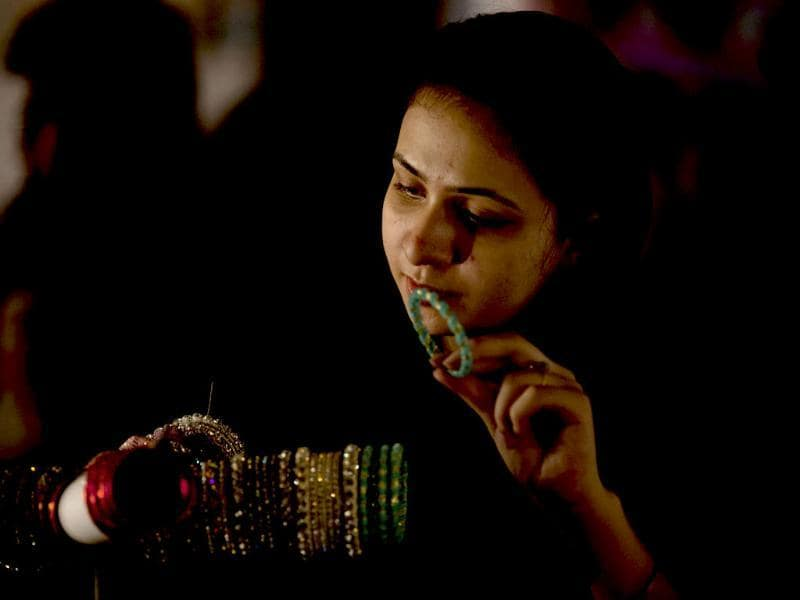 A Pakistani girl buys bangles ahead of the Muslim Eid al-Fitr holiday in Islamabad, Pakistan. (AP Photo)