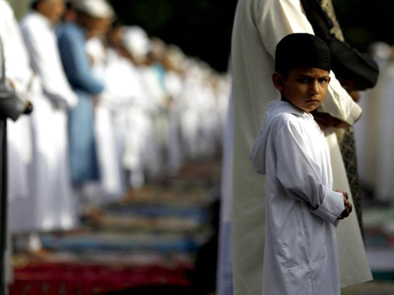 A Muslim boy looks on during a prayer session to celebrate Eid al-Fitr at the Santa Maria La Antigua University car park (Reuters)
