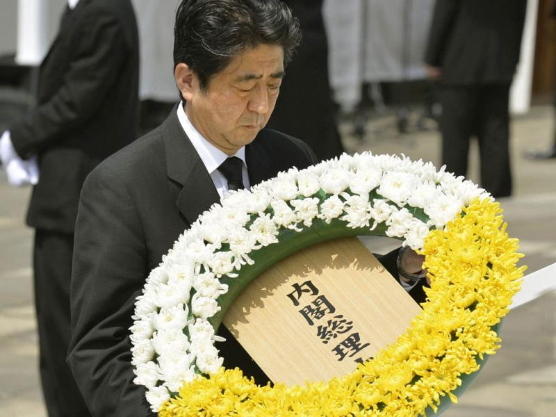 Japan's Prime Minister Shinzo Abe offers a flower wreath for victims of the 1945 atomic bombing during a ceremony commemorating the 68th anniversary of the bombing of the city at Peace Park in Nagasaki. Reuters photo