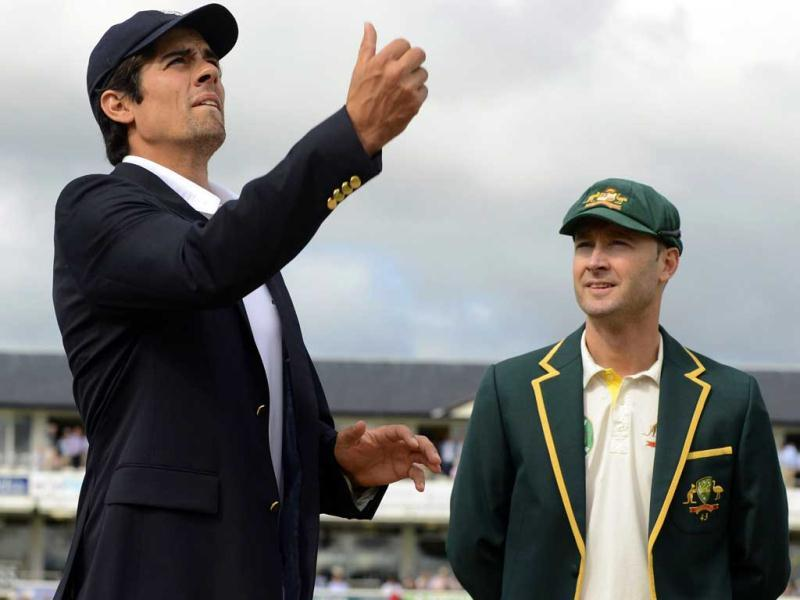 England's captain Alastair Cook (L) tosses the coin as Australia's captain Michael Clarke looks on before the fourth Ashes Test at the Riverside cricket ground in Chester-le-Street. (Reuters Photo)