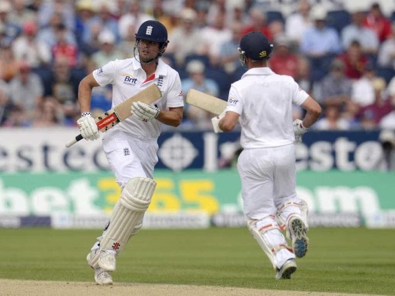 England's Alastair Cook (L) runs with teammate Jonathan Trott during the fourth Ashes Test at the Riverside ground in Chester-le-Street. (Reuters Photo)
