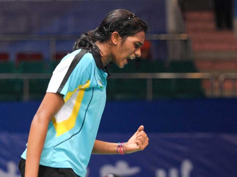 PV Sindhu reacts after gaining a point during the women's single quarterfinal match against China's Wang Shixian at the World Badminton Championships in Guangzhou. Sindhu won 21-18, 21-17. (AFP Photo)
