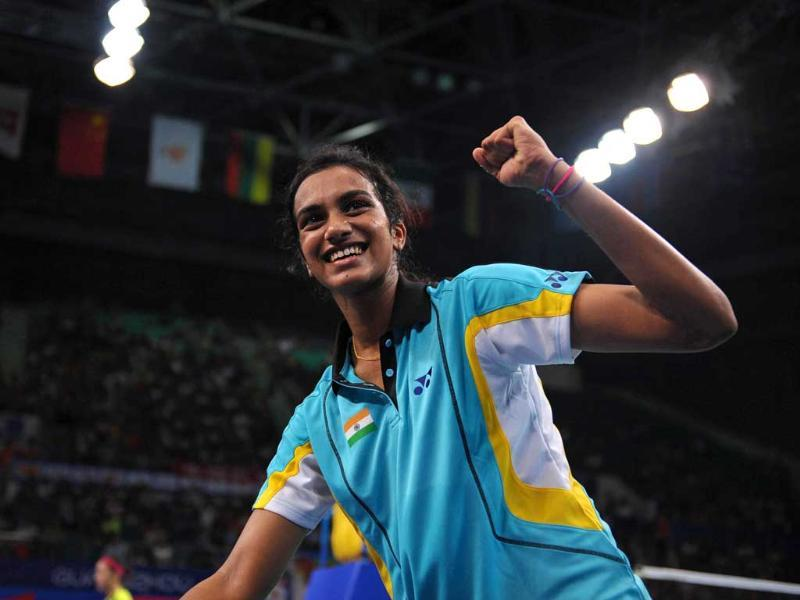 Pusarla Venkata Sindhu celebrates after winning the women's single quarterfinal match against China's Wang Shixian during the World Badminton Championships in Guangzhou, south China. (AFP Photo)