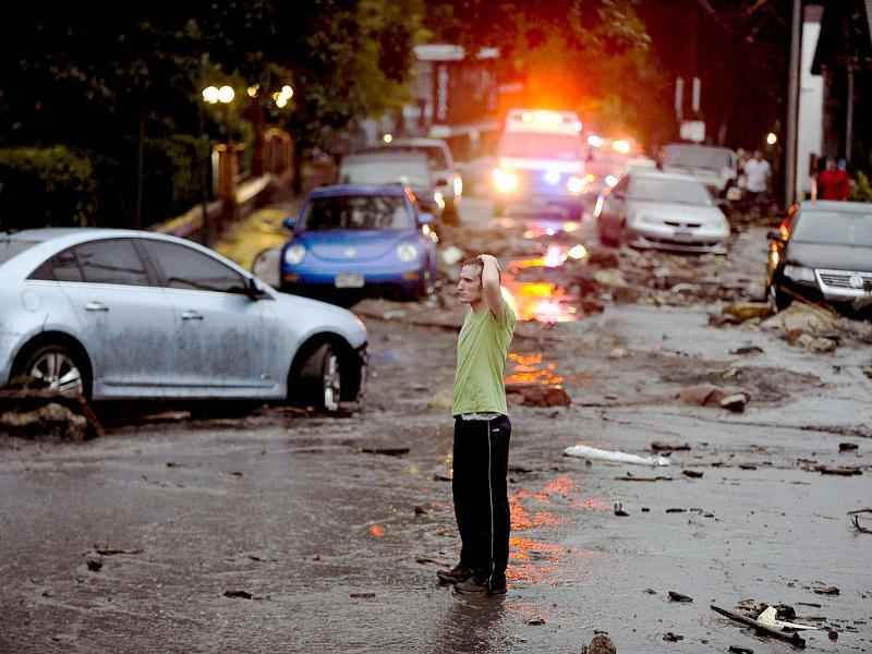 A man stands in the middle of the destruction caused by a flash flood that poured down in Manitou, Colorado, USA. (AP Photo)