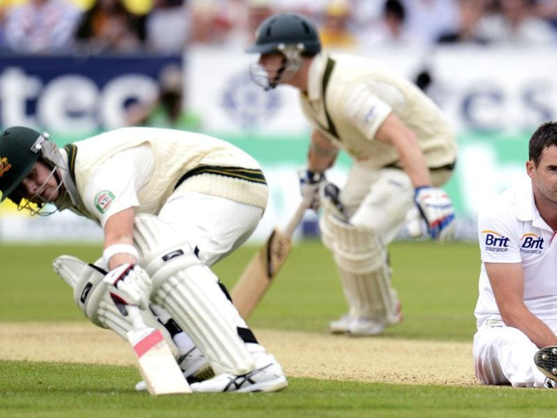 England's James Anderson sits on the ground as Australia's Chris Rogers and Steve Smith (L) run during the fourth Ashes Test at the Riverside ground in Chester-le-Street. (Reuters Photo)