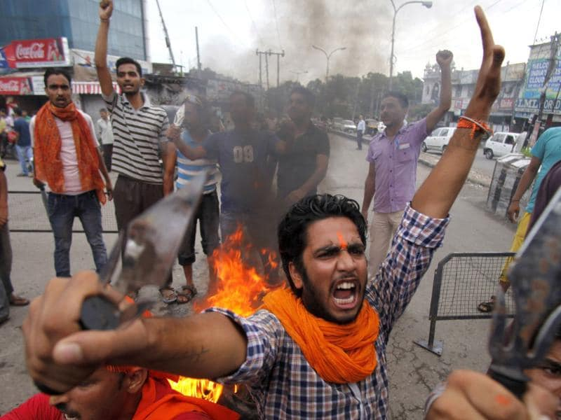 A Hindu protestor shouts slogans against the state government after rival communities clashed in Kishtwar, in Jammu. (AP Photo)