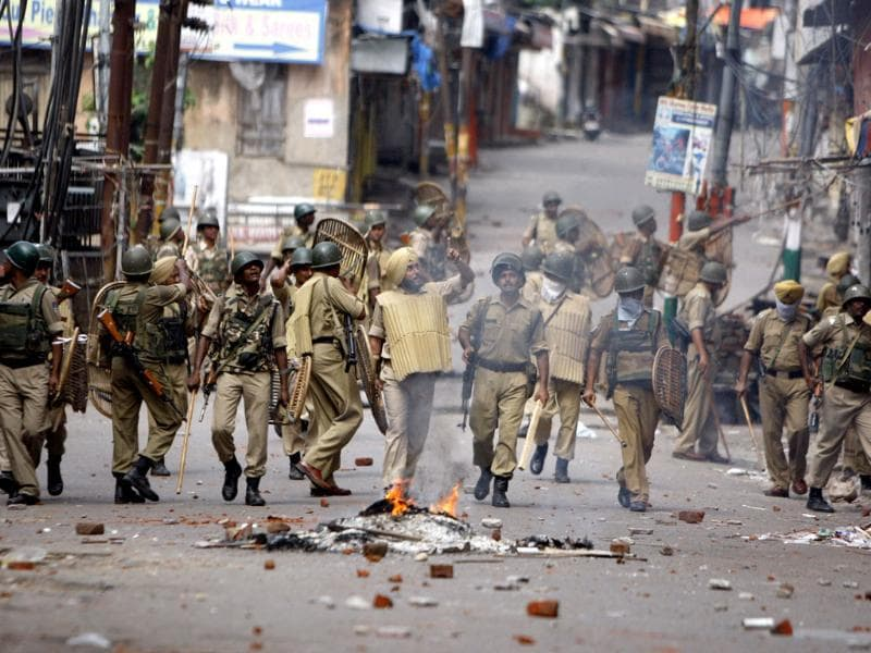 Paramilitary soldiers patrol during a protest against the state government after rival communities clashed in Kishtwar, in Jammu. (AP Photo)