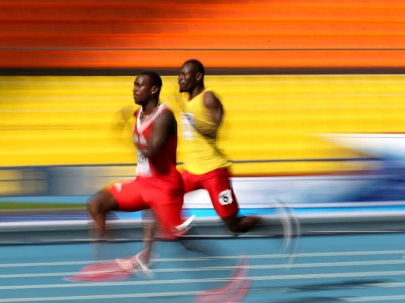 Guinea-Bissau's Holder da Silva (L) and Antigua's Daniel Bailey run during the men's 100 metres qualifications at the 2013 IAAF World Championships at the Luzhniki stadium in Moscow. (AFP Photo)