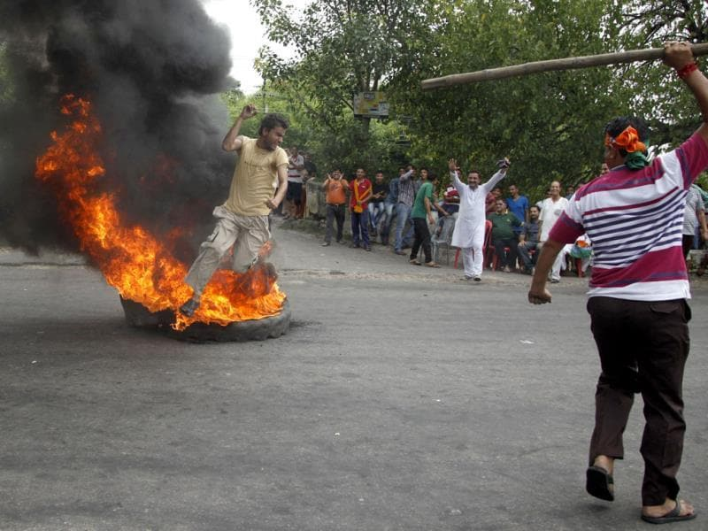 BJP activists stage a protest against the Jammu and Kashmir government during a curfew in Jammu. (AP Photo)
