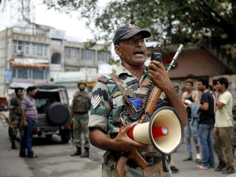 An Army soldier makes an announcement to the public during a curfew in Jammu.(AP Photo)