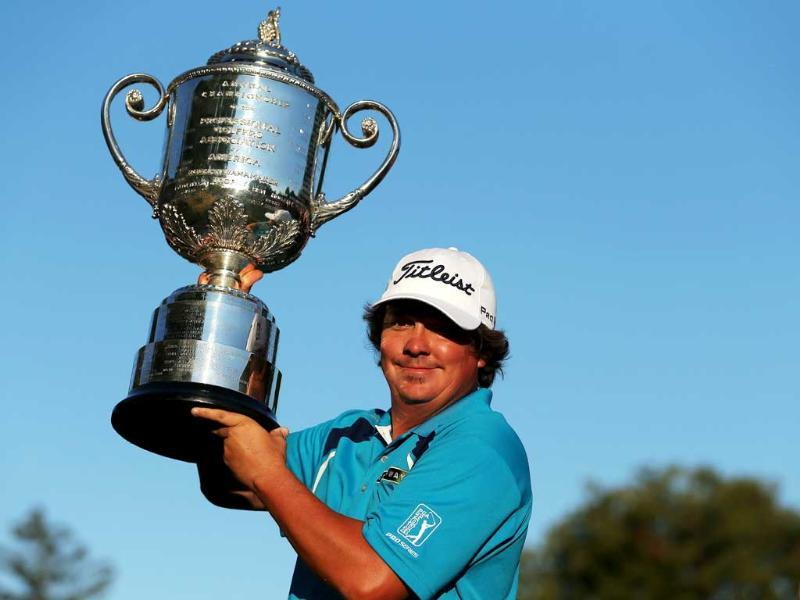 Jason Dufner of the United States poses with the Wanamaker Trophy after his two-stroke victory at the 95th PGA Championship at Oak Hill Country Club in Rochester, New York. AFP
