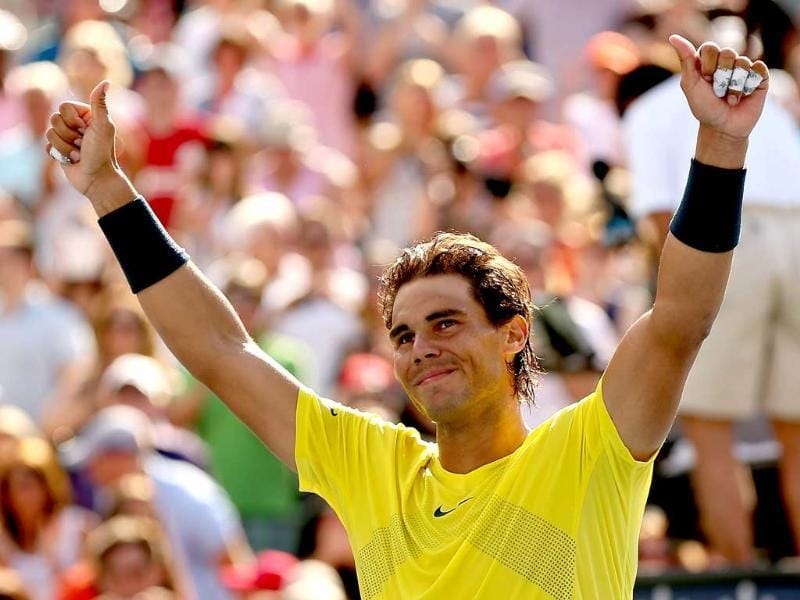 Rafael Nadal of Spain celebrates his win over Milos Roanic of Canada during the final of the Rogers Cup at Uniprix Stadium in Montreal, Quebec, Canada.  AFP