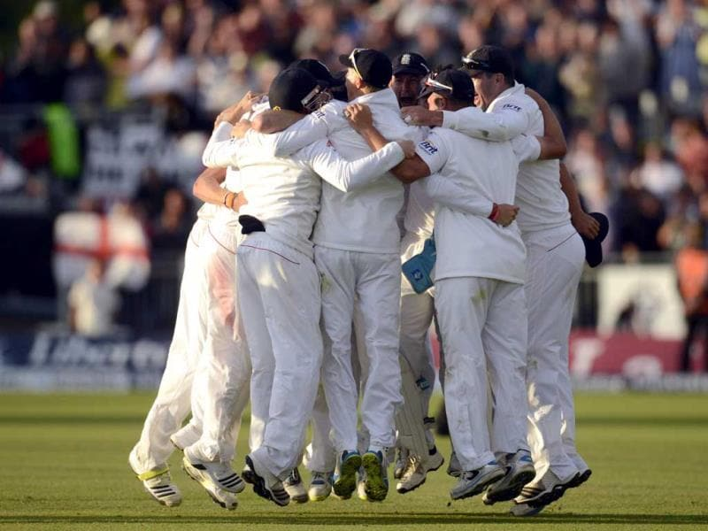 The England players celebrate after winning the fourth Ashes cricket test match against Australia at the Riverside cricket ground in Chester-le-Street near Durham. (Reuters Photo)