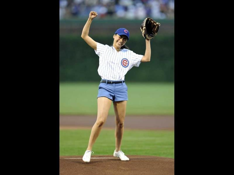 Actress Aimee Garcia reacts after throwing out the first pitch before the Cincinnati Reds and Chicago Cubs baseball game in Chicago. (AP Photo)