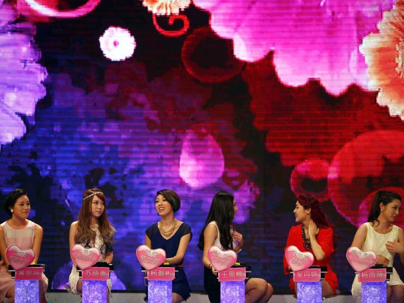 Women talk during the recording of an episode of a matchmaking television programme,