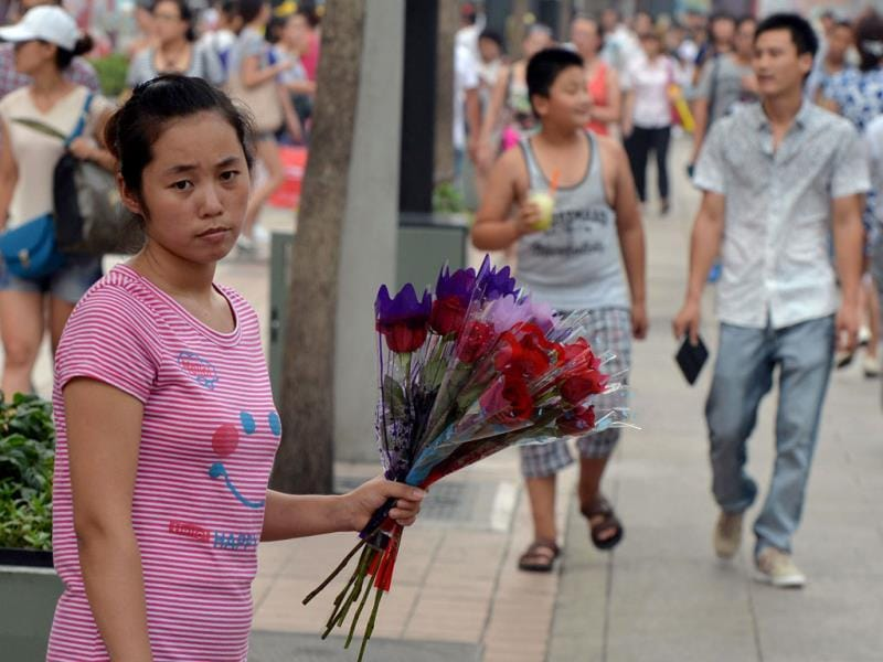 A young girl holds roses during the Qixi festival which is also known as the 'Chinese Valentine's Day' in Beijing. AFP