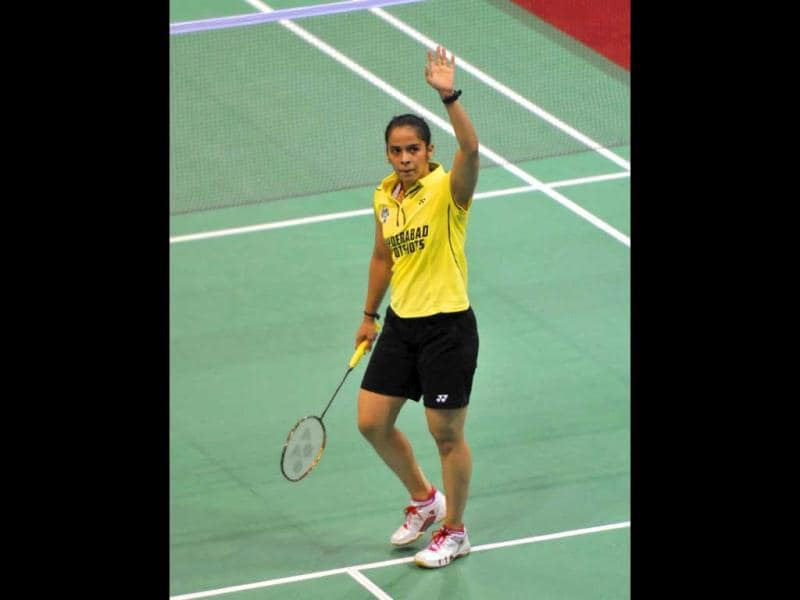 Saina Nehwal waves after her win against PV Sindhu in the women's singles on the second day of the Indian Badminton League (IBL) at Sirifort Indoor Stadium in New Delhi (Vipin Kumar/HT)