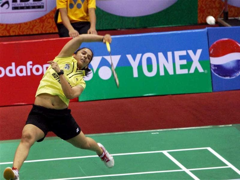 Hyderabad Hotshots player Saina Nehwal in action against Awadhe Warriors player P V Sindhu during the Indian Badminton League 2013 match in New Delhi on Thursday (PTI).
