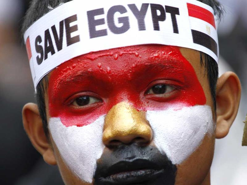 An Indonesian Muslim man with his face painted in the colors of the Egyptian flag takes part in a rally calling for an end to the violence used against the supporters of ousted President Mohammed Morsi in Egypt. (AP Photo)