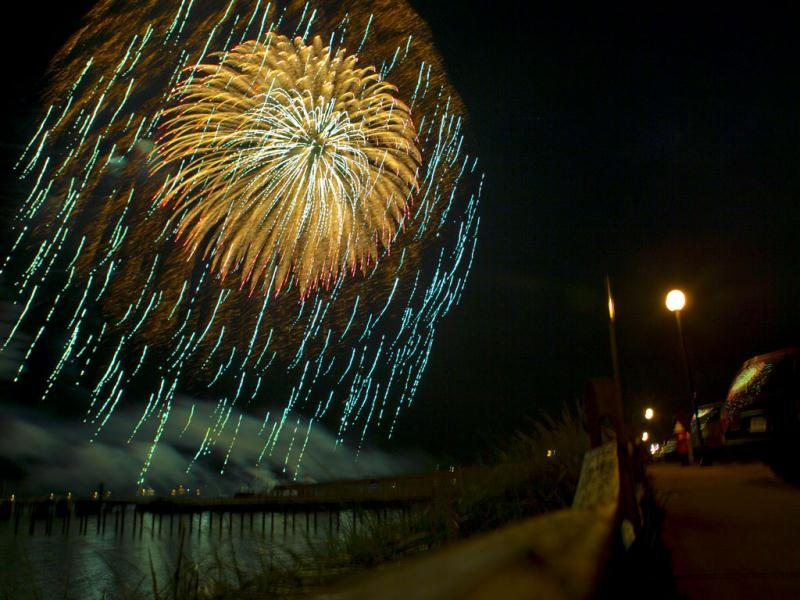 Fireworks explode overhead near where President Barack Obama and the first family were watching the display from inside Valerie Jarrett's rental house, in Oak Bluffs, Massachusetts. (AP Photo)