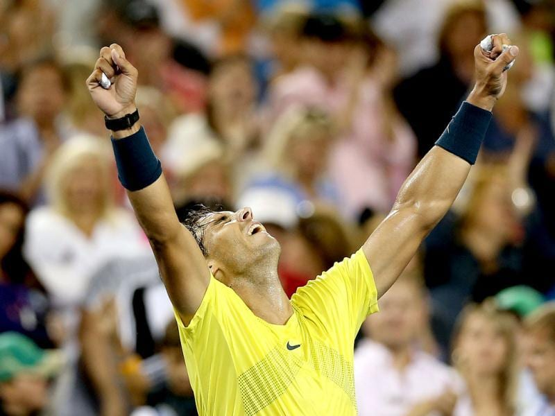 Rafael Nadal of Spain celebrate his win over Roger Federer of Switzerland during the Western & Southern Open on August 16, 2013 at Lindner Family Tennis Center in Cincinnati, Ohio. (AFP Photo)