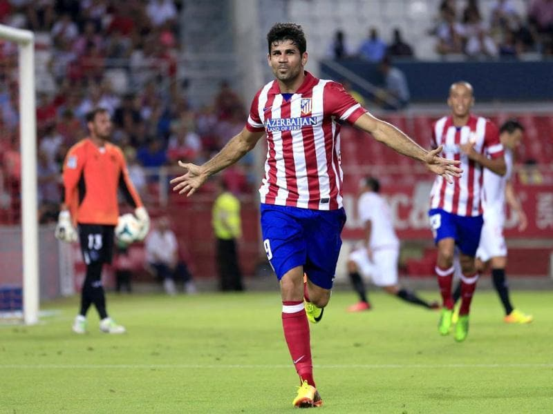 Atletico Madrid's Diego Costa celebrates after scoring against Sevilla during their Spanish First Division soccer match at Ramon Sanchez Pizjuan stadium in Seville. (Reuters Photo)