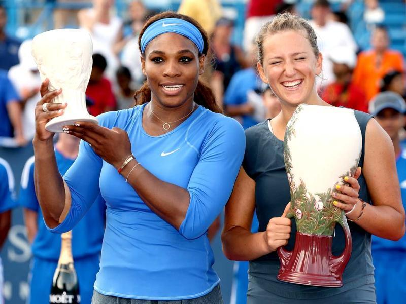Serena Williams and Victorioa Azarenka of Belarus poses for photographers at the trophy ceremony during the final of the Western & Southern Open at Lindner Family Tennis Center in Cincinnati, Ohio. (AFP Photo)