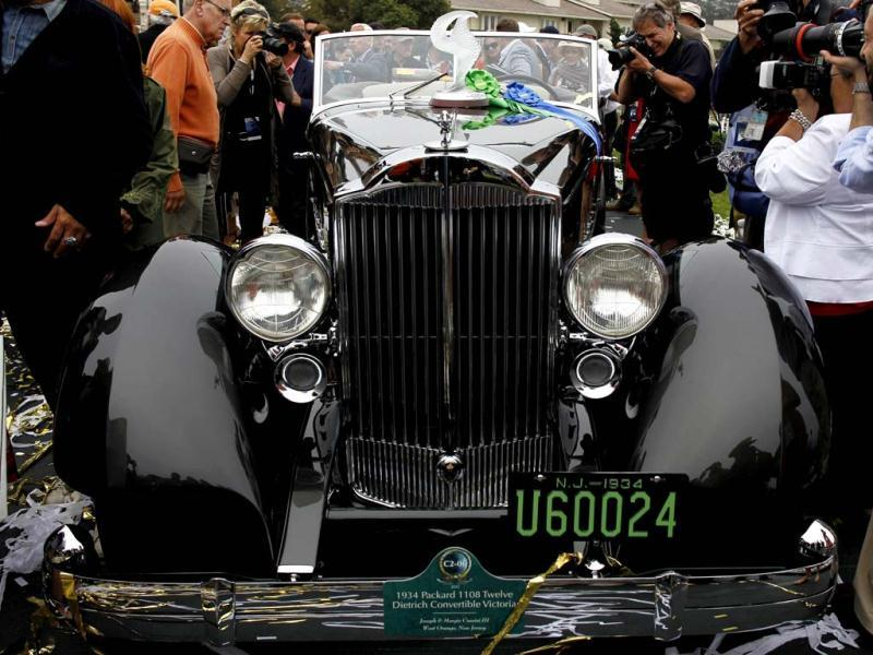 Photographers crowd around the Best of Show winner, a 1934 Packard 1108 Twelve Dietrich Convertible Victoria, owned by Joseph Cassini, at the Concours d'Elegance in Pebble Beach, California. (Reuters Photo)
