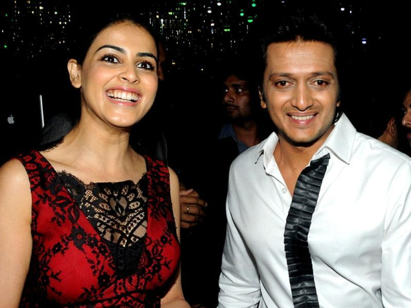 Ritesh Deshmukh and his wife Genelia D'Souza attend the 50th birthday bash of film actress Sridevi in Mumbai on August 17, 2013. (AFP Photo)