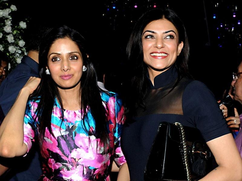 Sushmita Sen and Sridevi are happy posing for the shutterbugs in Mumbai on August 17, 2013. (AFP Photo)