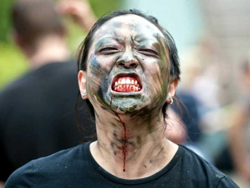 A woman dressed up like a zombie poses for a picture during a 'Zombie training day' in Hyde Park, Central London. AFP photo