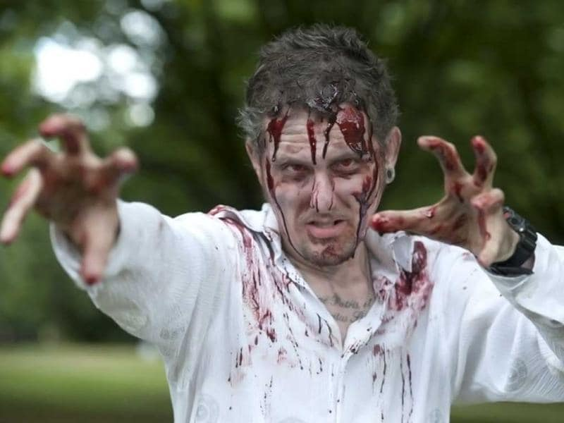 A man dressed up like a zombie poses for a picture during a 'Zombie training day' in Hyde Park, Central London. AFP photo