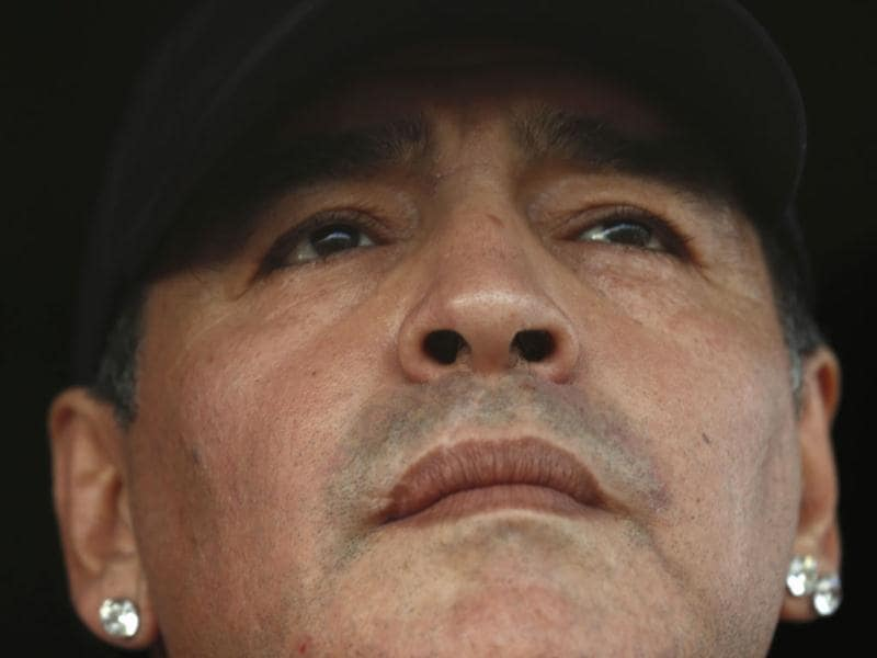 Former Argentina captain and coach Diego Maradona watches the Primera D championship soccer match between Deportivo Riestra and San Miguel in Buenos Aires. (Reuters)
