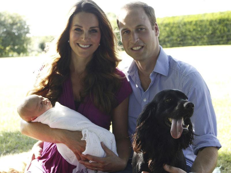 This image taken by Michael Middleton, the Duchess's father, and supplied by Kensington Palace, shows the Duke and Duchess of Cambridge with their son, Prince George, in the garden of the Middleton family home in Bucklebury, England, with their pet dog. (AP Photo)