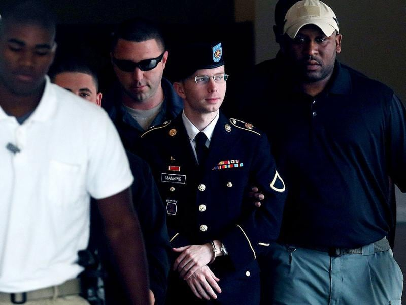 US Army Private First Class Bradley Manning is escorted out of a military court facility during the sentencing phase of his trial in Fort Meade, Maryland. (AFP Photo)