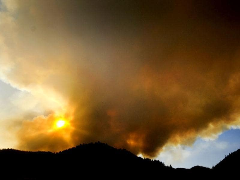 The Lolo Complex of fires sends up a large smoke plume. The fire gained strength toward the end of the day, making what one fire official called