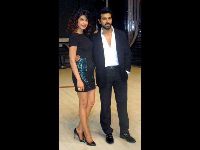 Priyanka Chopra and Ram Charan pose during the promotion of Zanjeer, directed by Apoorva Lakhia, on the set of the Jhalak Dikhhla Jaa in Mumbai on August 20, 2013. (AFP Photo)