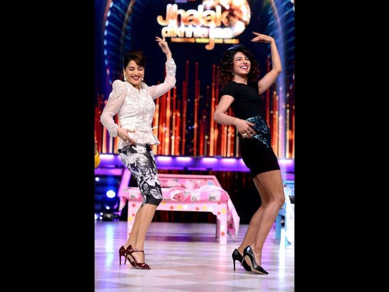 Madhuri Dixit and Priyanka Chopra get grooving on the sets of Jhalak Dikhhla Jaa. Madhuri is one of the judges on the reality dance show. (PTI Photo)