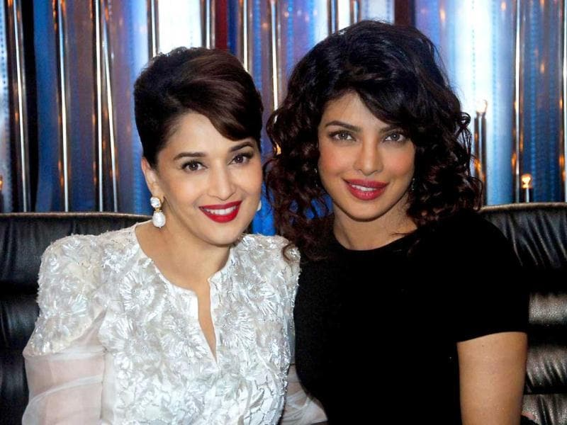 When dancing diva Madhuri Dixit and style icon Priyanka Chopra are in the same frame, explosive is the word to describe it. Glamour doesn't get any better than this combination of ladies in black and white! Browse through. (AFP Photo)