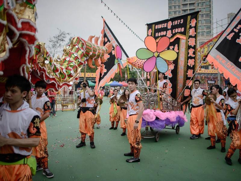 Performers get ready for a parade for the Hungry Ghost Festival in Hong Kong. (AFP Photo)