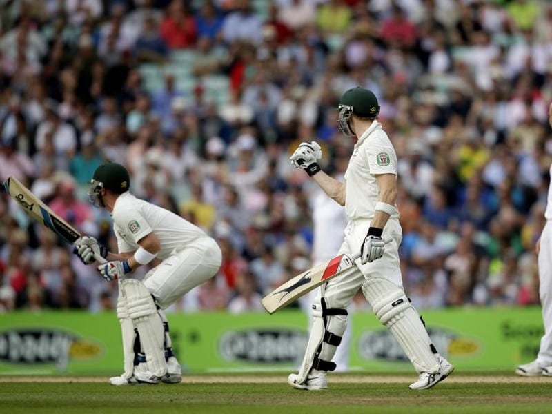 Australia's Steven Smith (C) reacts after hitting a six off England's Jonathan Trott (R) to reach his century, with teammate Brad Haddin (L) on the fifth Ashes Test The Oval. (AP Photo)
