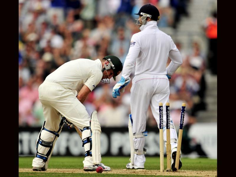 Australia's Brad Haddin is bowled by England's Jonathan Trott (not pictured) on the second day of the fifth Ashes Test at The Oval cricket ground in London. (AFP Photo)