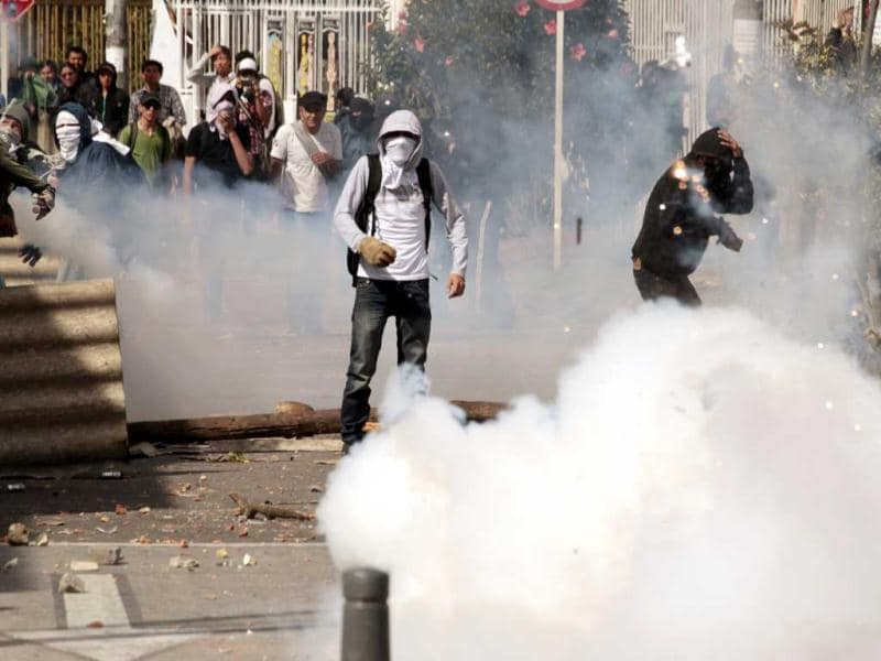 Student demonstrators clash with riot police during heavy protests in Bogota. (Reuters)