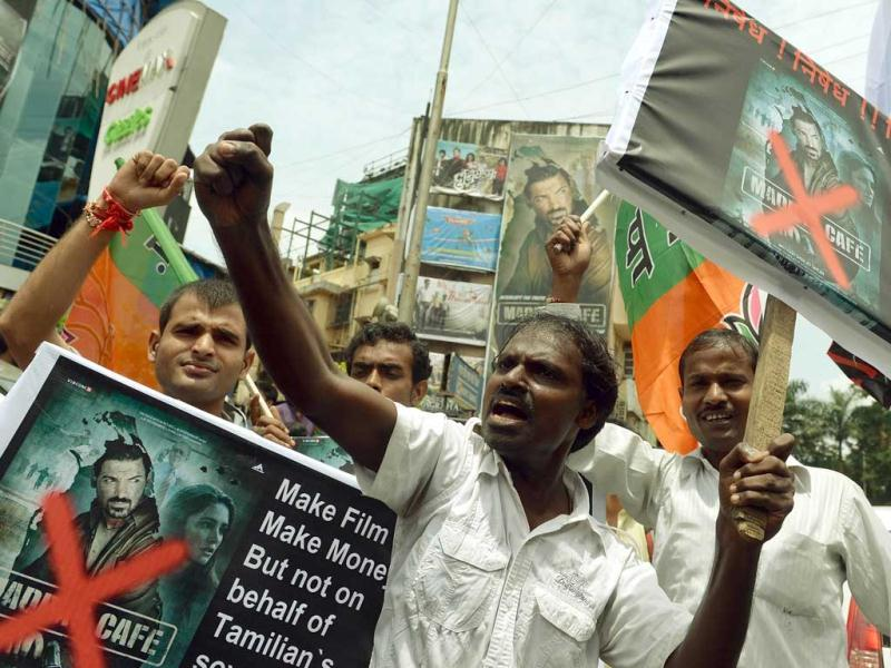 Tamils and Bharatiya Janta Party (BJP) supporters carry placards as they shout slogans during a protest against the release of Madras Cafe outside a movie hall in Mumbai on August 22, 2013. (AFP Photo)