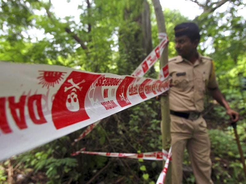 A policeman inspects the site where a journalist was gang-raped in Mahalaxmi area in Mumbai. (AFP)