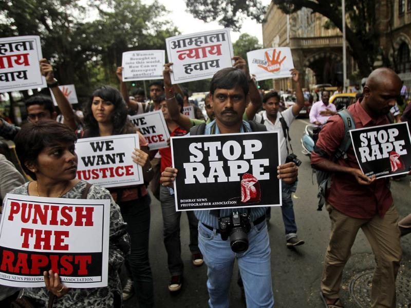 Photojournalists hold placards as they protest against the gangrape of a 22-year-old woman photojournalist in Mumbai. (AP Photo)