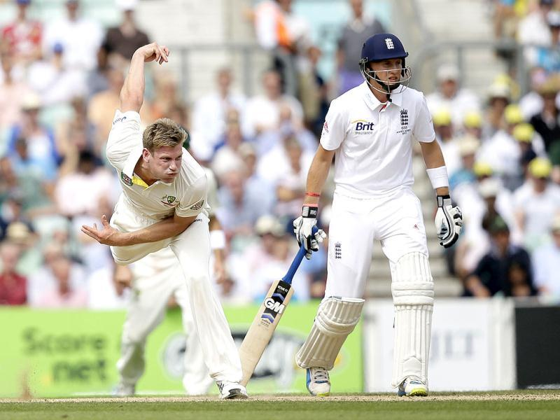 England's Joe Root looks on as Australia's James Faulkner bowls to England's Jonathan Trott during play on the third day of the fifth Ashes Test at The Oval in London. (AP Photo)