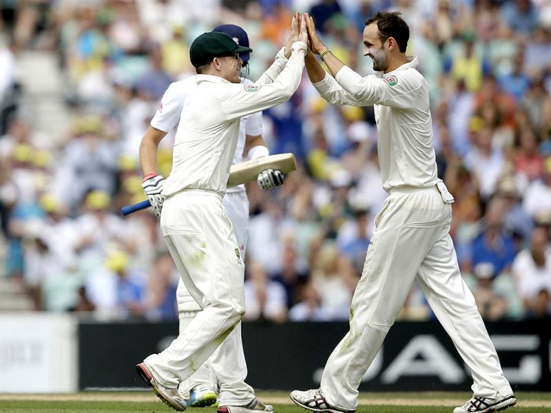 Australia's Nathan Lyon (R) celebrates after taking the wicket of England's Joe Root during play on the third day of the fifth Ashes Test at The Oval in London. (AP Photo)